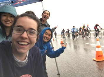 Supporting our teammates and staying (sort of) dry with our cyclist friend from USC, Liana, at the USC Road Race, 3/2/19
